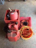 Multiple loose and wound extension cords, two funnels and glass cans in various sizes ranging from 1gal 4oz to 2gal 8oz