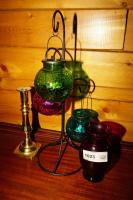 COLORED ART GLASS VASE, HANGING CANDLE GLOBES WITH WIRE FRAME STAND, AND HEAVY BRASS CANDLESTICK - GRT