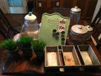 (12) Kitchen Decor Pcs., (1)EKCO 3 Loaf Pan, (3)Faux Grass in Containers, (1)Grandma's Kitchen Magnetic Board, (6)Cannisters, (1)Stainless Steel Pan
