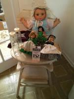 (8)Doll and Baby Pcs., (1)Wood Highchair, (1)UNEEDA Baby Doll, (3)Glass EVENFLO Bottles 2 with Nipples, (3)Vintage MADAME ALEXANDER International