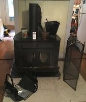"(7) Pcs. (1) Wood Heater with Element Blower 36"" x 25"" x 31"", (1) Fire Glove, (1) Fire Screen, (1) Fire Wood Holder, (1) Ash Bucket and Tools, (2) Dec"