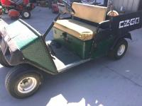EZGO GAS golf/utility cart with dump bed (no tail gate), bed it is bolted down, hours 10743