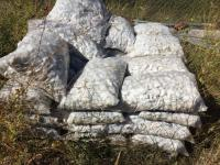 Approximately 35 bags white landscaping rock
