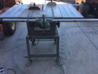 "Delta 10"" contractor's Saw on roller stand"