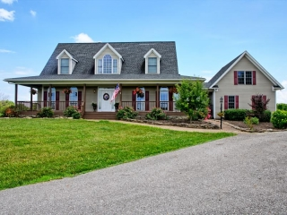 Real Estate:  Parcel 1:  Pristine 6700 sq ft home on 44+/- acres