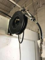 Retractable oil hose & reel, 1500 PSI, must be removed from wall