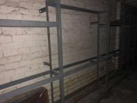 5' x 7' x 1' metal shelving units, must be on fastened from wall, 11 total units