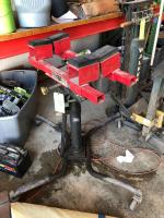 Rolling Transmission Jack with Sunex Fuel Tank Adaptor Attachment