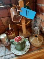 Various items including pound flour glass measure - wooden cup tree - misc.