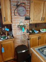 Wall decor needs to be gently removed - ice block tongs - comb base - coffee tray - wrought iron match holder - waste can - dustpan