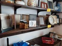 Shelf of picture frames and easels