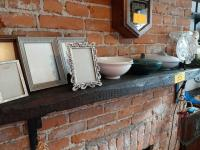 Contents of mantle - 3 - Boonton dishes - crystal - frames