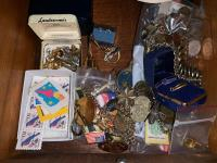Lot of misc costume jewelry, forgein money, 1954 and 1957 Wheat pennies, military medals and buttons