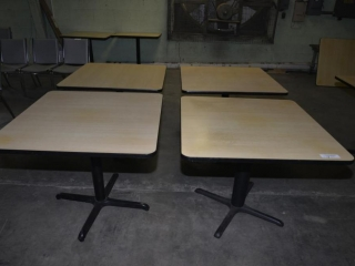 2 OAK GRAIN RESTAURANT TABLES 36 X 36 - ROUND METAL PEDASTAL, 4 LEG BASED - USED, VERY MINOR SCRATCHES AND DISCOLORATION