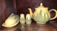 Shawnee pottery pitcher, covered butter dish, salt and pepper