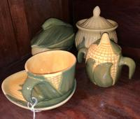 Shawnee Pottery cup and saucer,2 covered dishes (one with crack), double handle covered dish