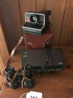 Polaroid camera; alarm clock: vintage binoculars