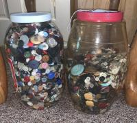 Two large containers of buttons