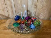 Glass basket with decorative eggs, one is marble