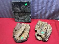 2 Vintage ball gloves, and a stone cutting board