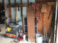 Fence posts, Fishing tackle box & misc tools-contents of wall