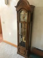 Howard-Miller Clock Co. Model No. 610-160, in working condition. 77 inches tall Very well kept