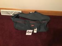 Assorted travel and duffle bags