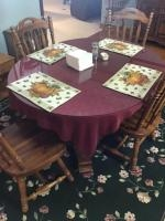 Oval Kitchen Table with 4 chairs, with glass protective top. Table is 40 inches wide w/ extra leaf
