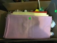 Box of assorted linens and cleaning supplies