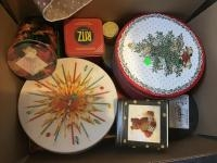 Box of assorted tins, including a Ritz Tin