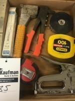 Group of staplers, Tape Measures, and rivet gun