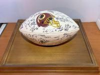 Washington Redskins signed football in case.