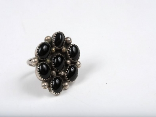Sterling silver and 7 onyx ring