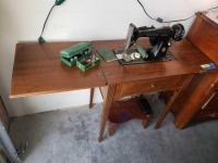 """Singer sewing machine with accessories and stool Serial AK332065 Measures 51"""" w/ leaves open x 17â..."""