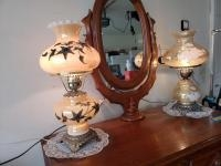 2 electrified hurricane style lamps One has a design done in relief w metal? This lamp does have a h...
