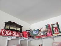 CocaCola items-street sign, tins, clock(plastic), Monopoly game NIB, Barbie, animation bear and more