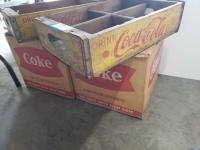 2 wooden coke carriers and four 1 gallon glass Coke bottles in original cardboard boxes