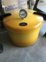 Presto pressure cooker and quantity of canning jars