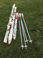 3 pair of snow skis and 2 sets of K2 poles Mickey K2 skis, child's Mickey K2 skis and Kevlar K2 sk...