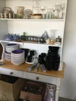 Quantity of dinnerware including service for 8 of the black stoneware, other misc. pieces and flatwa...