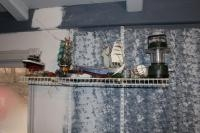 Assortment of model boats, (2) watches and a battery powered lantern