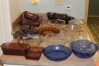 Assortment of Pyrex and Anchor Brand glassware dishes