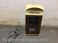 Older telephone booth w/ telephone