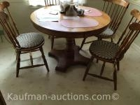 Oak Pedestal Table w/ 4 Chairs & extra leaf