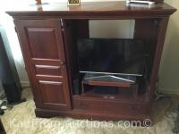 Wooden Entertainment center/ Contents not included