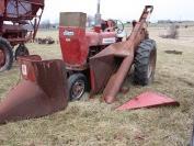 Farmall 450 with mounted 2 row corn picker