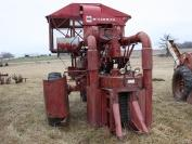 Farmall 450 Diesel with mounted 4 M1 20 cotton picker