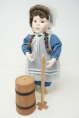COLLECTIBLE BISQUE PORCELAIN DOLL WITH STAND AND ACCESSORIES