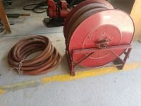 FIRE HOSE REEL AND MOUNTING RACK WITH EXTRA HOSE, REEL IS APPROXIMATELY 29 IN DIAMETER