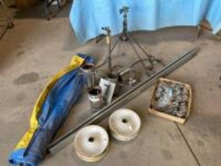 Sprinklers, rails (approximately 5) with rollers, rims for yard cart, banner tarp, stove pipe